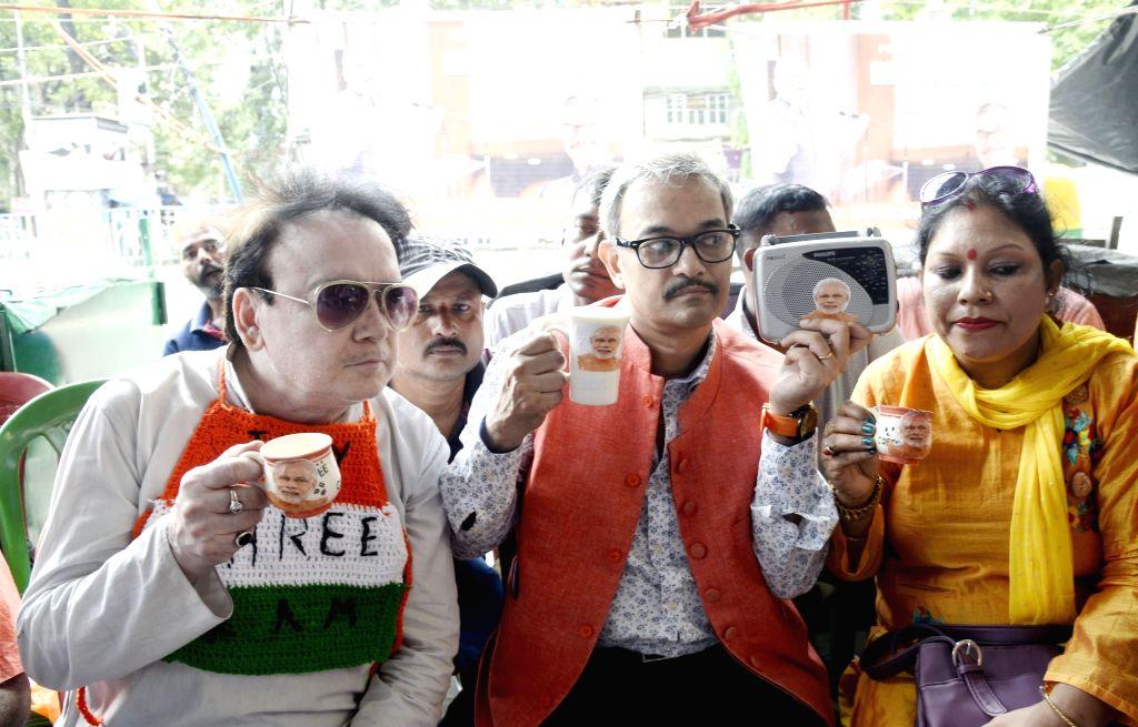 "BJP workers listening to Prime Minister Narendra Modi's ""Mann Ki Baat"" on a radio set in Kolkata on July 28, 2019. - Narendra Modi"