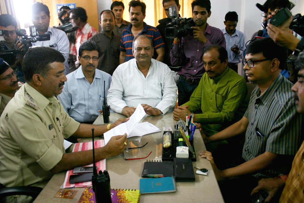 BJP workers lodge complaint against Congress president Sonia Gandhi at a police station for allegedly displaying provocative material in her party's official website in Bhopal on April 11, 2014.