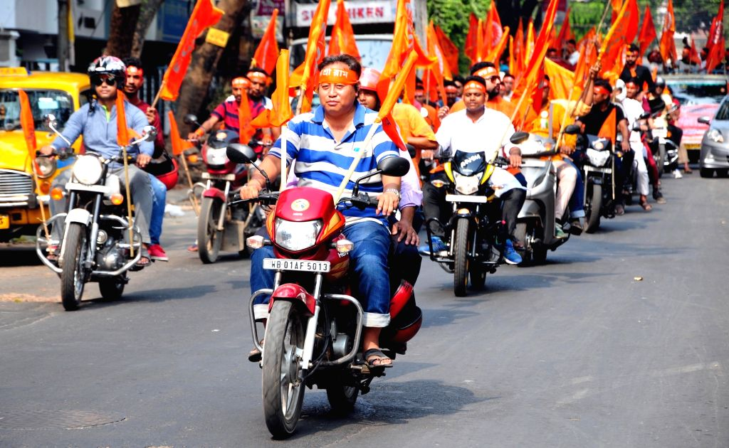 BJP workers participate in a bike rally organised on Ram Navami in Kolkata, on March 25, 2018.