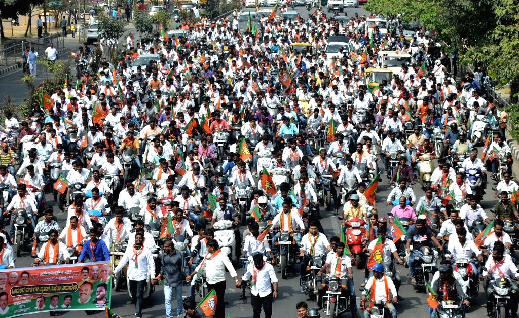 BJP workers participate in a party rally in Bengaluru, on Nov 27, 2016.