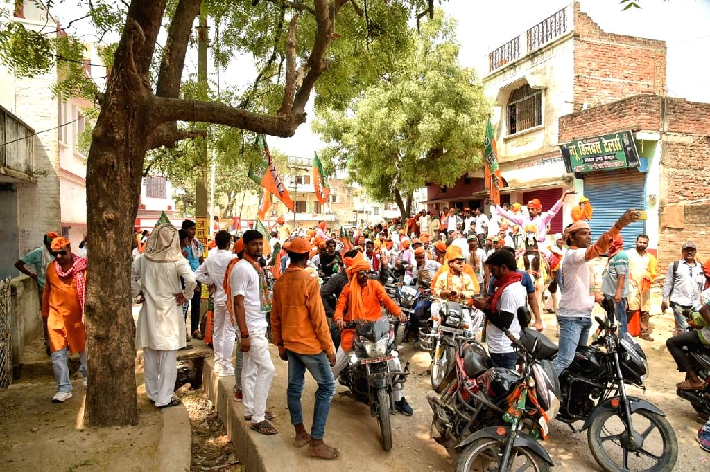 BJP workers participate in a roadshow by the party's Lok Sabha candidate from Buxar, Ashwini Kumar Chaubey, ahead of his filing of nomination for the forthcoming Lok Sabha elections, in ... - Ashwini Kumar Chaubey