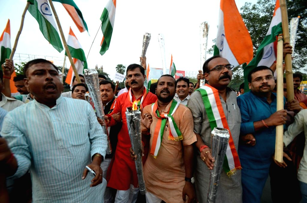 """BJP workers participate in """"Mashal Juloos"""" -torch rally- on the eve of Independence Day in Patna on Aug 14, 2016."""