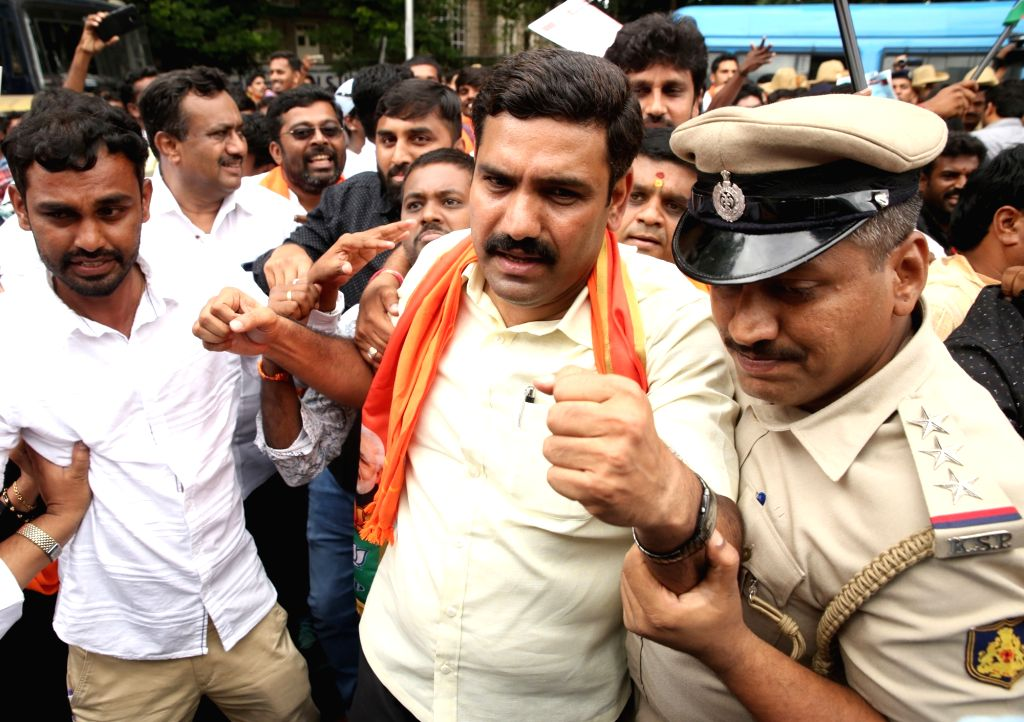 BJP workers protesting against the Karnataka Government for allotment of land to JSW Steel to set up a facility in Toranagallu of Ballari district;  being taken into custody in Bengaluru ...