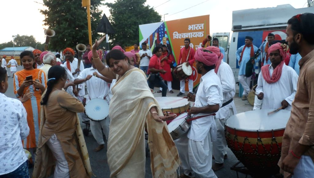 BJP workers seen in celebration mood as they wait to welcome Prime Minister Narendra Modi, who will return to India after concluding a week-long US visit, at Palam Air Force Station in New ... - Narendra Modi