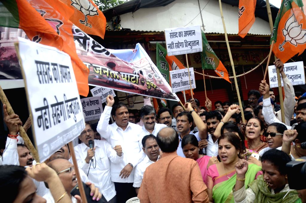 BJP workers stage a demonstration against stalling of Parliament proceedings by Congress MPs; in Mumbai, on Aug 16, 2015.