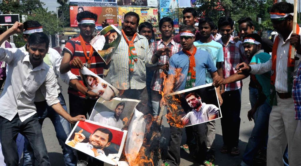 BJP workers stage a demonstration against Congress vice president Rahul Gandhi in Patna, on Oct 7, 2016. - Rahul Gandhi
