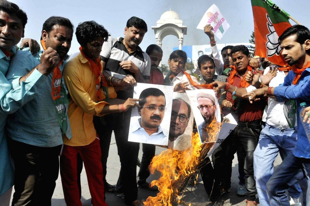BJP workers stage a demonstration against Congress leader Digvijay Singh, Delhi Chief Minister Arvind Kejriwal and AIMIM chief Asaduddin Owaisi in Patna on Nov 1, 2016. - Arvind Kejriwal and Digvijay Singh