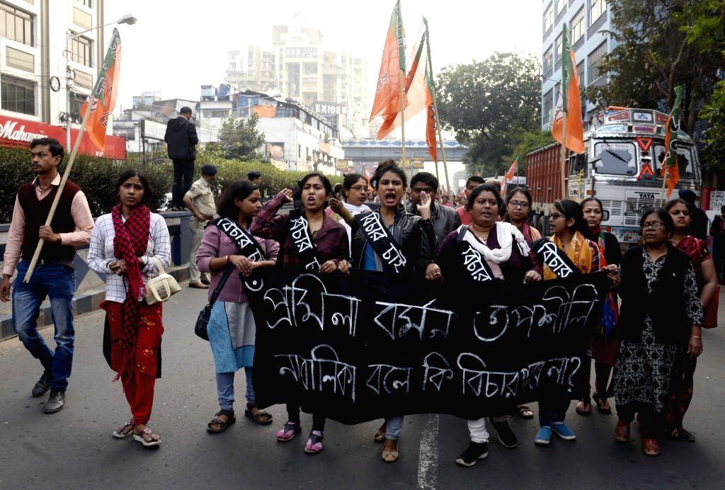 BJP workers stage a demonstration against Kumarganj rape case, in Kolkata on Jan 10, 2020.