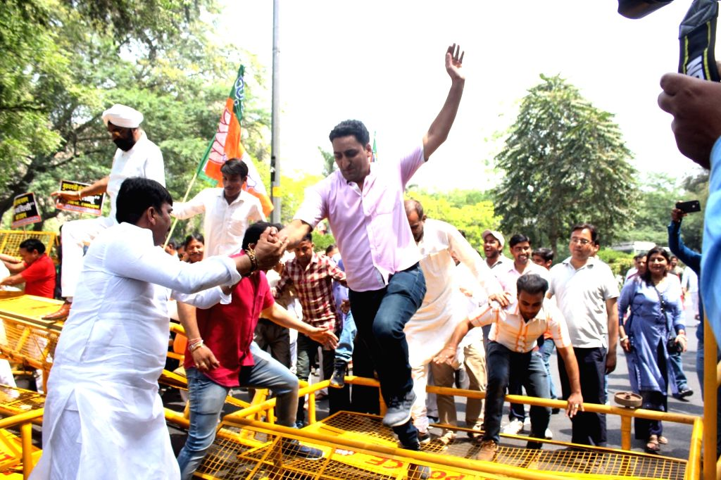 BJP workers stage a demonstration against AAP government over alleged ration scam near Delhi Assembly, on April 5, 2018.