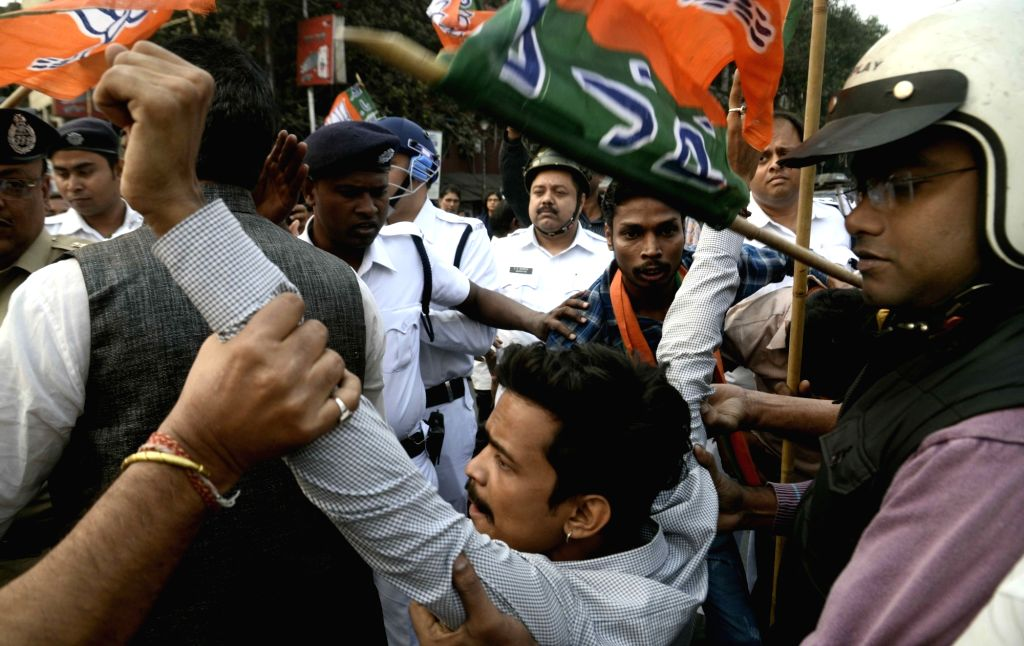 BJP workers stage a demonstration against an attack on West Bengal (WB) BJP president Dilip Ghosh's vehicle, in Kolkata on Dec 7, 2018. Ghosh's vehicle was attacked by miscreants on Thursday ... - Dilip Ghosh