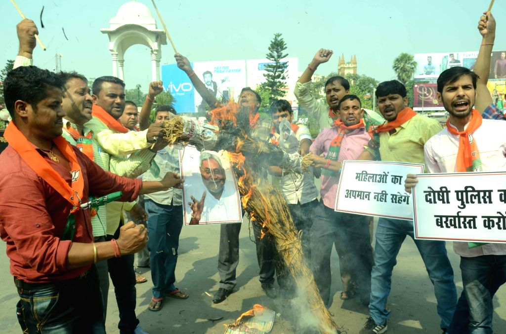 BJP workers stage a demonstration against Bihar Chief Minister Nitish Kumar in Patna on Oct 19, 2016. - Nitish Kumar