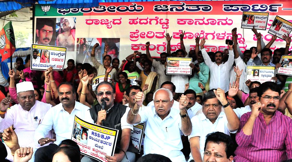 BJP workers stage a demonstration against death of an RSS worker in Bengaluru on Oct 19, 2016.