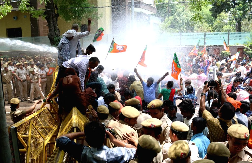 BJP workers stage a demonstration against Delhi Chief Minister Arvind Kejriwal in front of his residence in New Delhi, on May 31, 2016. - Arvind Kejriwal