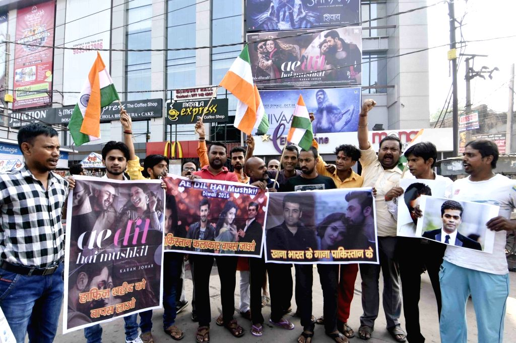 "BJP workers stage a demonstration against Karan Johar's film ""Ae Dil Hai Mushkil"" that features Pakistani actor Fawad Khan in Patna, on Oct 28, 2016. - Fawad Khan"