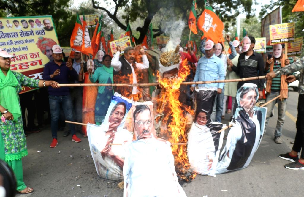 BJP workers stage a demonstration against Rahul Gandhi, Mamata Banerjee, Arvind Kejriwal, Akhilesh Yadav and Mayawati in New Delhi, on March 8, 2019. - Rahul Gandhi, Mamata Banerjee, Arvind Kejriwal and Akhilesh Yadav