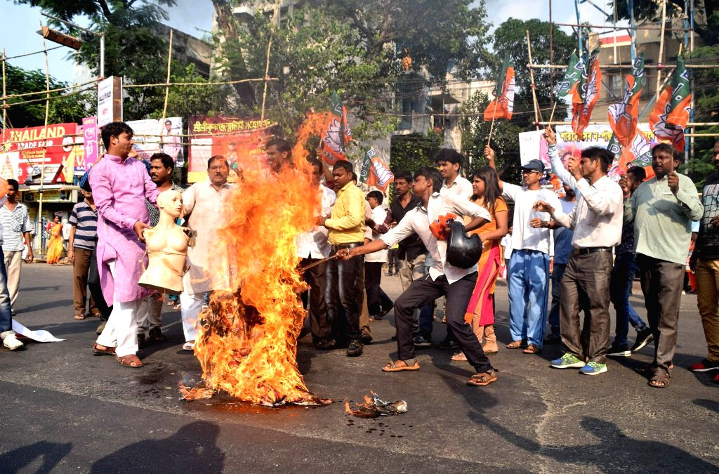 BJP workers stage a demonstration against the West Bengal Government, in Kolkata on Sept 18, 2018.