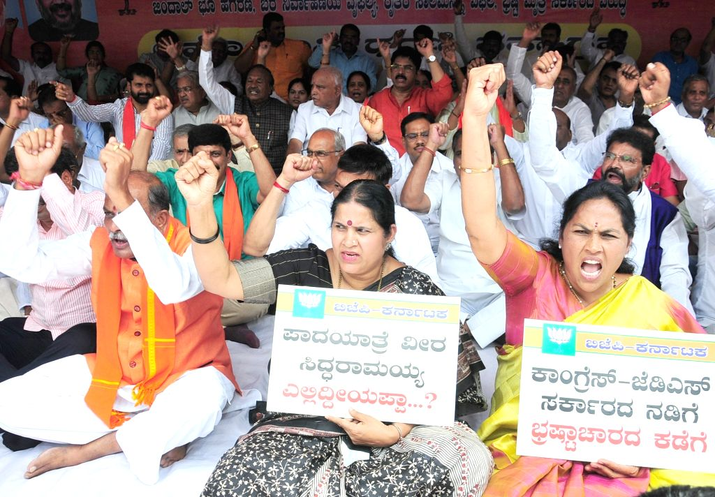 BJP workers stage a demonstration against the state government over Jindal land deal in Bengaluru on June 14, 2019.
