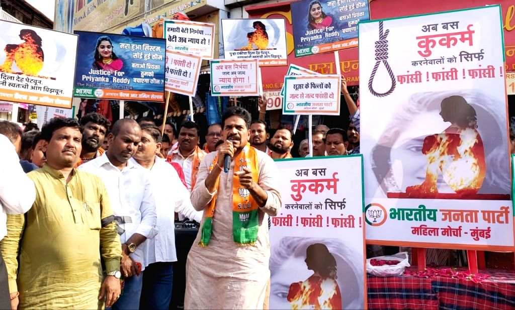 BJP workers stage a demonstration against the gruesome gang rape and murder of a woman veterinarian in Hyderabad; demanding death penalty for the culprits, in Mumbai's Dadar on Dec 3, 2019.