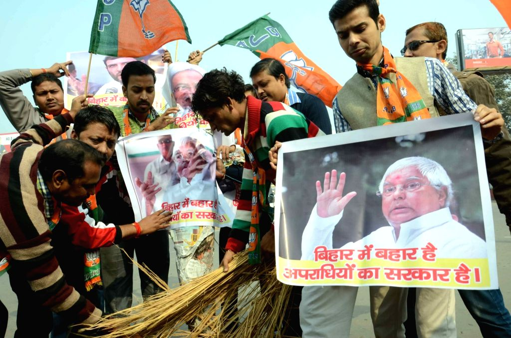BJP workers stage a demonstration agianst deteriorating law and order situation in Bihar; in Patna, on Jan 18, 2016.