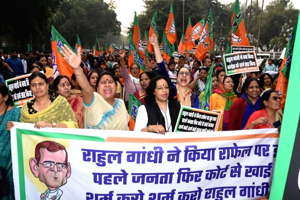 BJP workers stage a demonstration outside the Congress headquarters demanding an apology from Rahul Gandhi over his remarks on the Rafale verdict, in New Delhi on Nov 15, 2019. - Rahul Gandhi