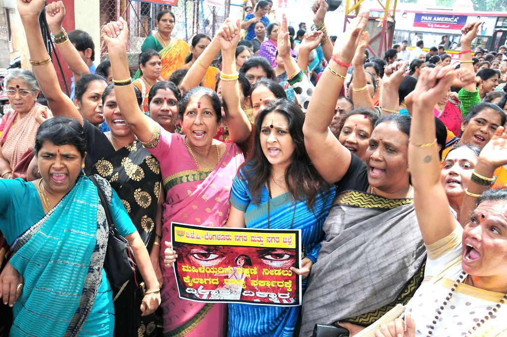 BJP workers stage a demonstration to press for safety of women in Bangalore on July 17, 2014.