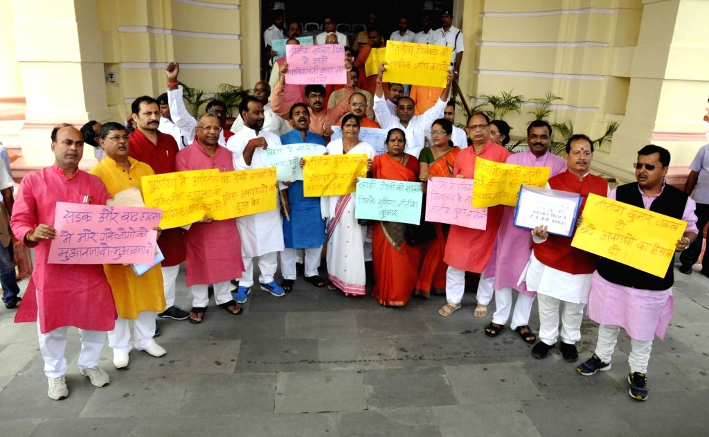 BJP workers stage a demonstration to press for their demands at Bihar assembly in Patna, on Aug 2, 2016.