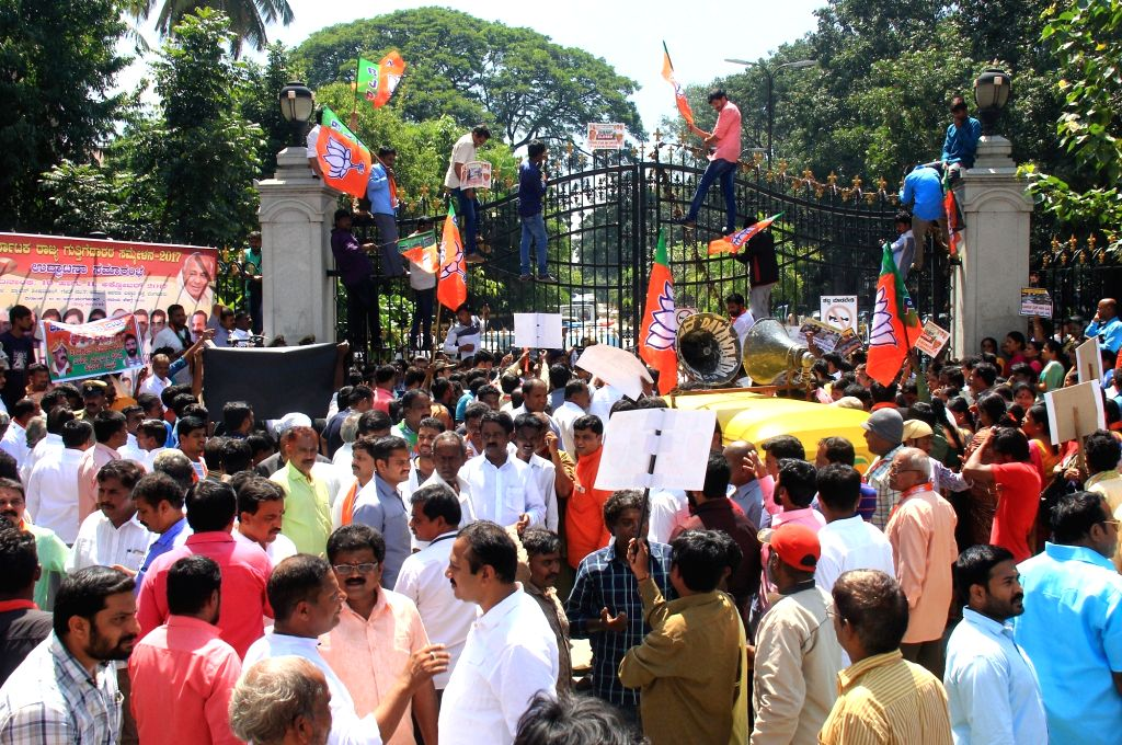 BJP workers stage a demonstration to press for their demands outside Bruhat Bengaluru Mahanagara Palike (BBMP) office in Bengaluru on Oct 11, 2017.