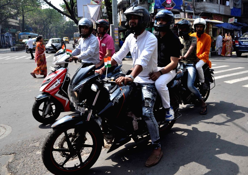 BJP workers take out a bike rally ahead of the Lok Sabha polls, in Kolkata, on March 3, 2019.
