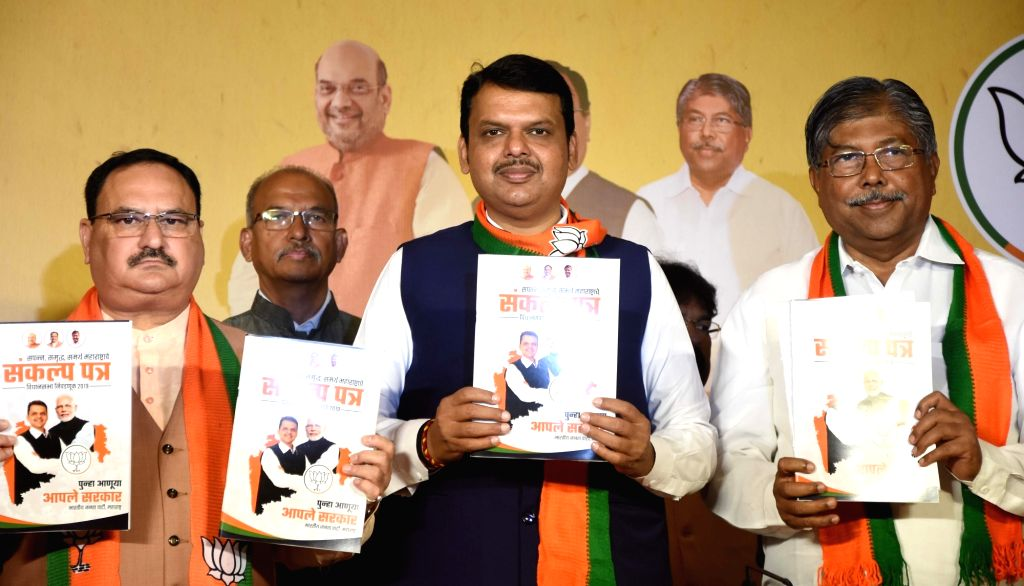 BJP Working President JP Nadda and Maharashtra Chief Minister Devendra Fadnavis at the launch of party's manifesto for upcoming state assembly polls in Mumbai on Oct 15, 2019. - Devendra Fadnavis