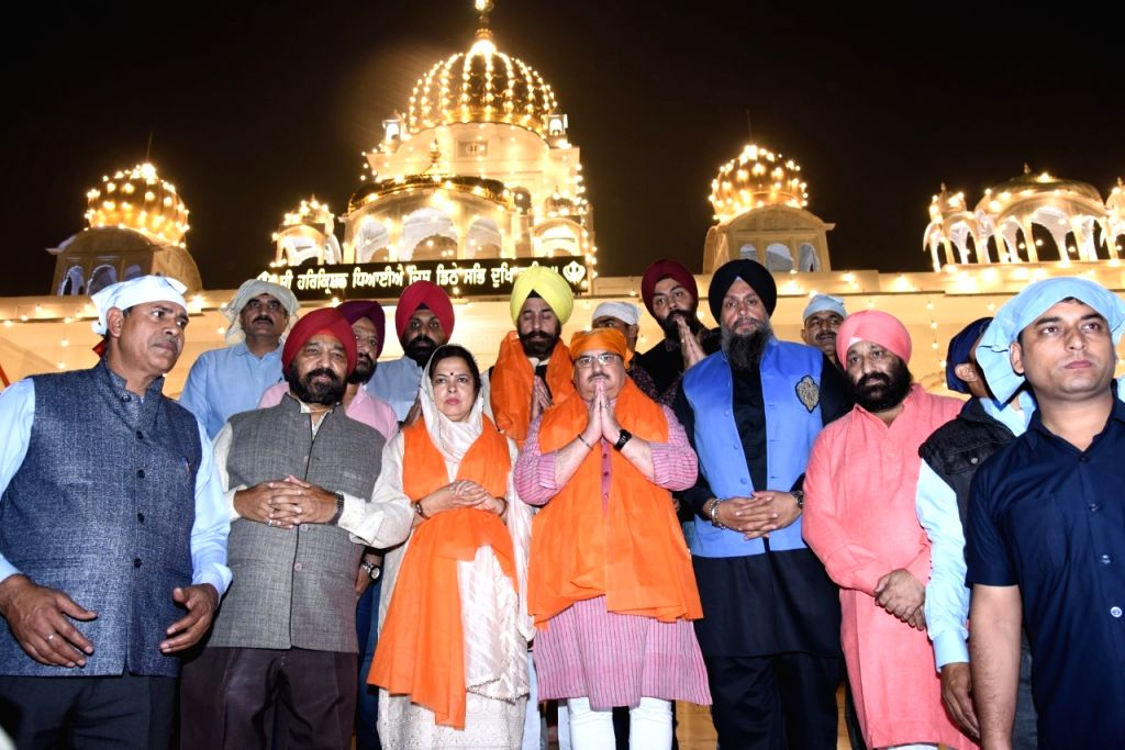BJP working president JP Nadda and Meenakshi Lekhi pay obeisance at Bangla Sahib Gurdwara on the occasion of 55oth birth anniversary celebrations of Guru Nanak Dev in New Delhi on Nov 12, ... - Nanak Dev