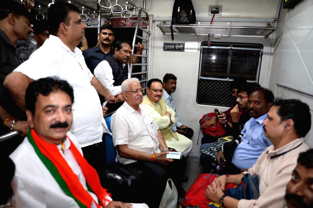 BJP Working President JP Nadda travels in a local train in Mumbai on Oct 17, 2019.