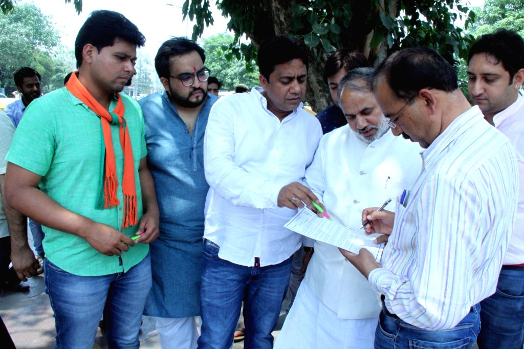 BJP Youth Wing activists conduct a signature campaign against Delhi Chief Minister Arvind Kejriwal in New Delhi on May 13, 2017. - Arvind Kejriwal