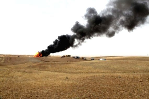 Black smoke is seen billowing from an oil well in the Bai Hassan oil field after it was blown up by IS militants in Kirkuk, Iraq, on May 5, 2021. - Hassan