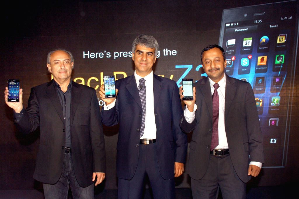 BlackBerry India MD Sunil Lalvani (C) and others during launch of Z3 - a Z series smartphone in New Delhi on June 25, 2014.