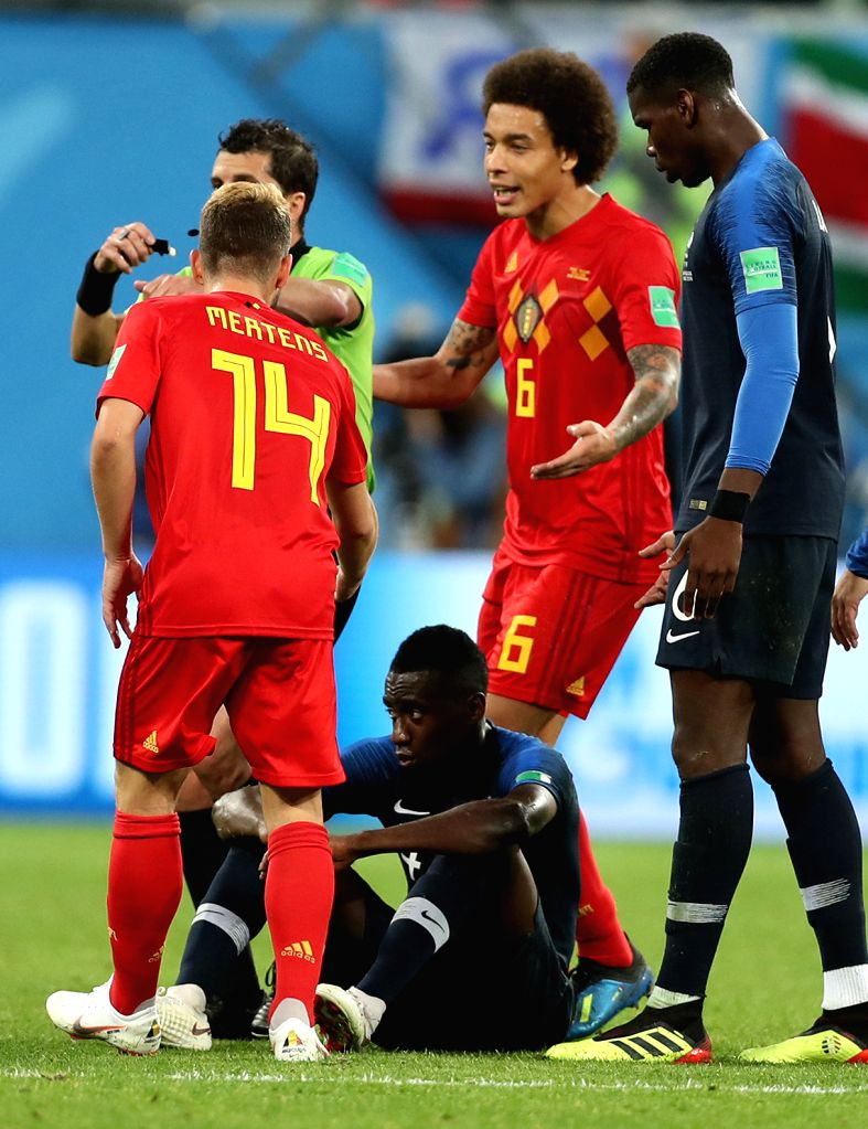 Blaise Matuidi (bottom) of France sits on the pitch during the 2018 FIFA World Cup semi-final match between France and Belgium in Saint Petersburg, Russia, ...