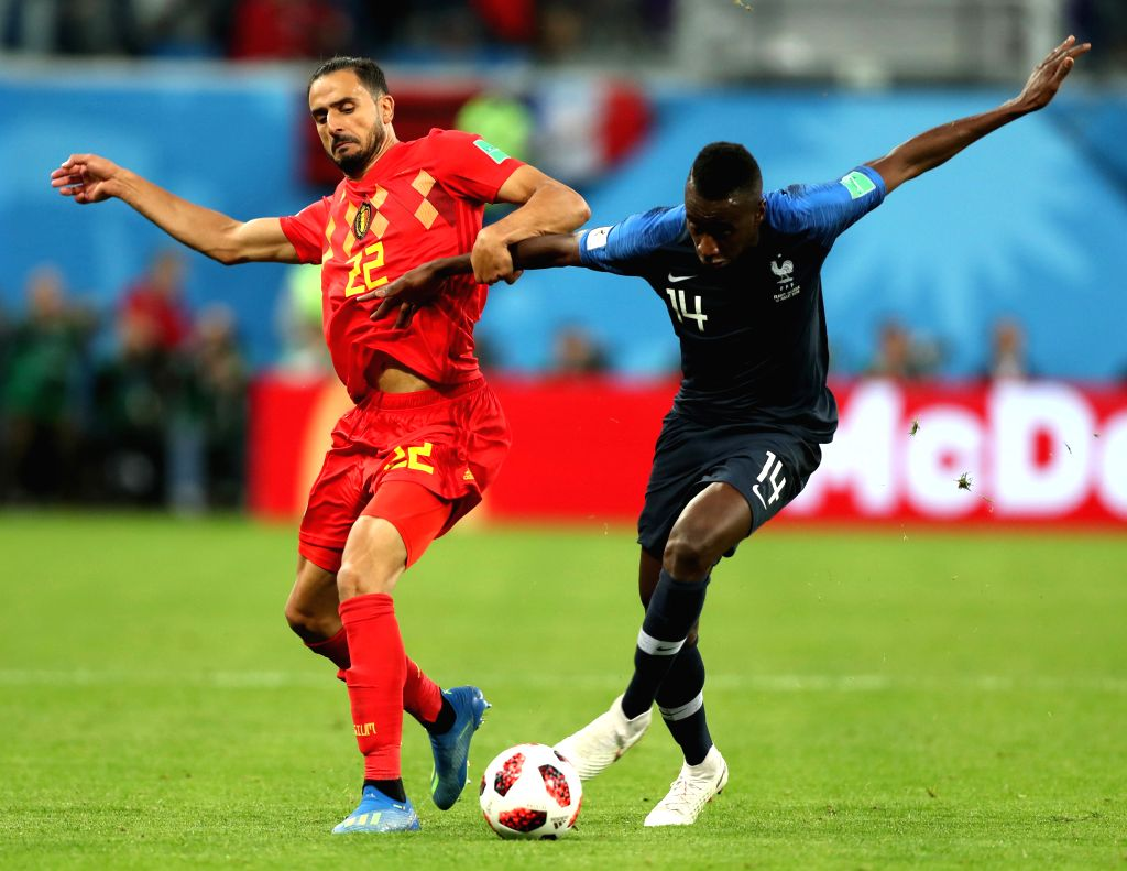 Blaise Matuidi (R) of France vies with Nacer Chadli of Belgium during the 2018 FIFA World Cup semi-final match between France and Belgium in Saint ...