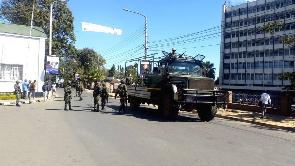 BLANTYRE, July 25, 2019 - Malawi Defense Force soldiers block a road in Blantyre, Malawi, on July 25, 2019. Post-election protests continued in Malawi on Thursday with an aim to force the country's ...