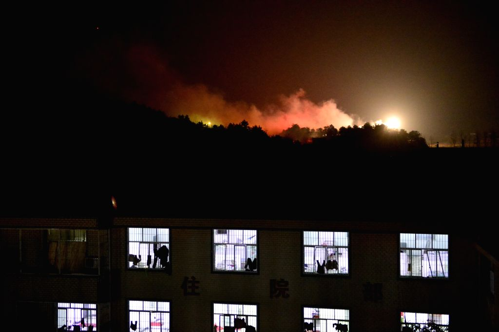 Blaze and smoke are seen at the blast site of Hongsheng fireworks plant at Kunshan Village in the Guangfeng District of Shangrao City, east China's Jiangxi ...