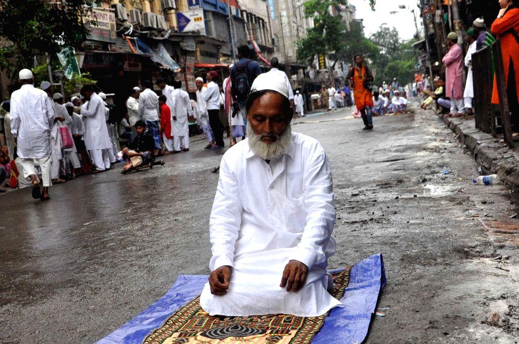 Blind people walk to offer prayer on the occasion of Eid-ul-Fitr at Nakhoda Masjid in Kolkata on June 26, 2017.