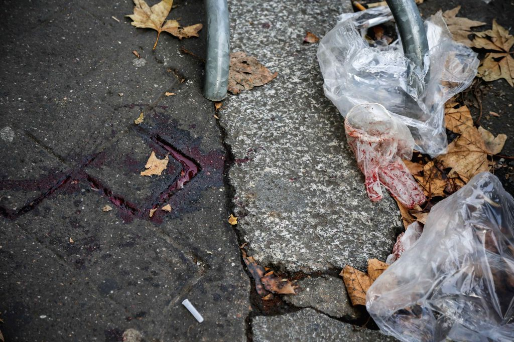 Bloodstain are seen on the ground outside the Bataclan concert hall in Paris, France, Nov. 14, 2015.