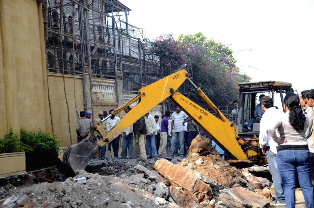 BMC personnel demolish the illegal ramp constructed outside actor Shah Rukh Khan's bungalow `Mannat` to park his vanity van, in Mumbai, on Feb 14, 2015. - Shah Rukh Kha and Rukh Khan
