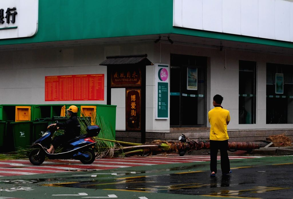 BOAO, July 18, 2018 - A coconut tree is blown down by strong wind caused by Typhoon Son-Tinh in Boao Town, Qionghai City, south China's Hainan Province, July 18, 2018. Son-Tinh, the ninth typhoon ...