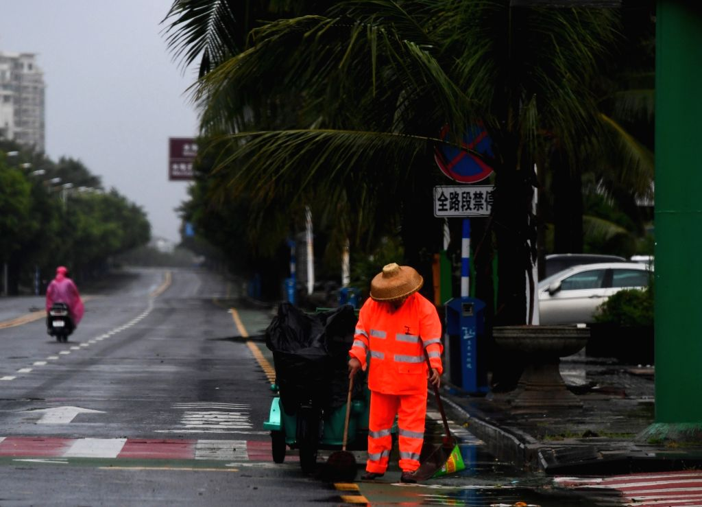 BOAO, July 18, 2018 - A sanitation worker clears up the street in Boao Town, Qionghai City, south China's Hainan Province, July 18, 2018. Son-Tinh, the ninth typhoon this year, made landfall at ...