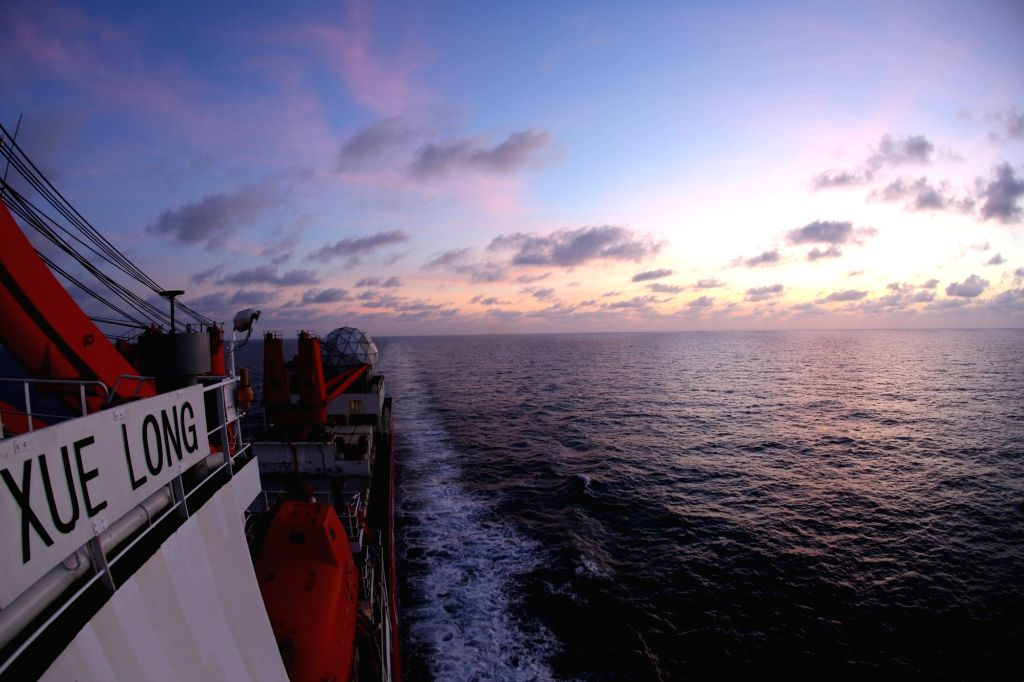 BOARD XUELONG, March 6, 2019 - Photo taken on March 5, 2019 shows the evening glow seen from China's research icebreaker Xuelong on the South China Sea. China's research icebreaker Xuelong, carrying ...