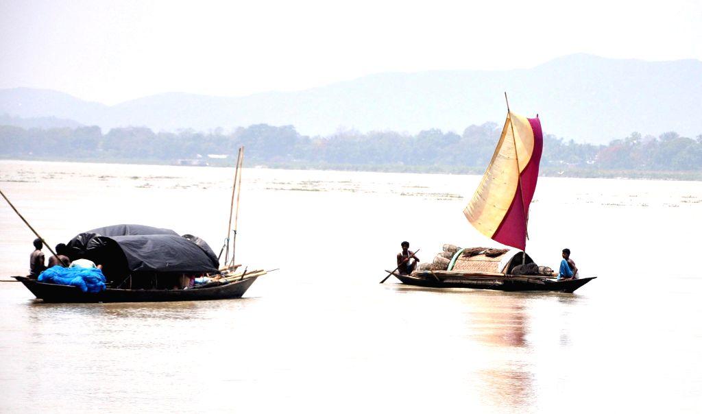 Boats on  Brahmaputra river near Guwahati on May 15, 2014.