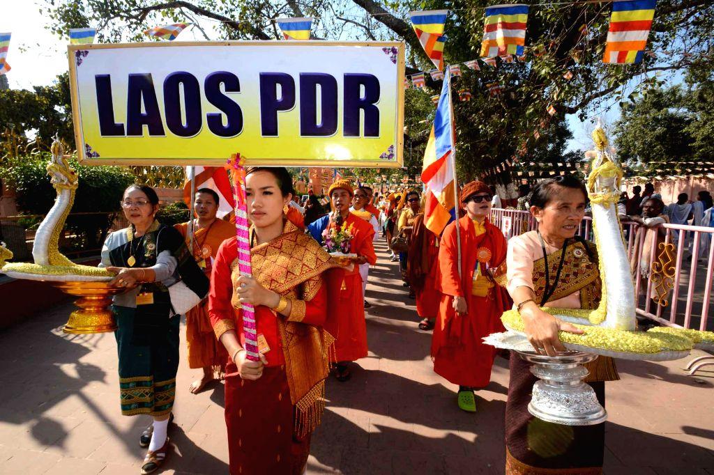 Bodh Gaya: Buddhist pilgrims during `Tipitaka Chanting Ceremony` in Bodh Gaya on Dec 2, 2014.