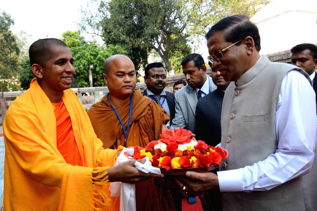 Bodh Gaya: Sri Lankan President Maithripala Sirisena being greeted on his arrival at Bodh Gaya, Bihar on Feb 17, 2015.