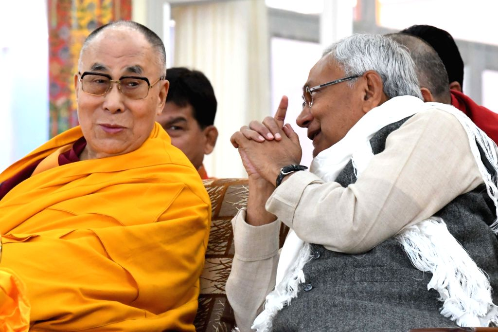 Bodh Gaya: Tibetan spiritual leader Dalai Lama with Bihar chief Minister Nittish Kumar and Tibetan Prime Minister in Exile Lobsang Sangay during Kalachakra in Bodh Gaya on Jan 14, 2017. - Nittish Kumar