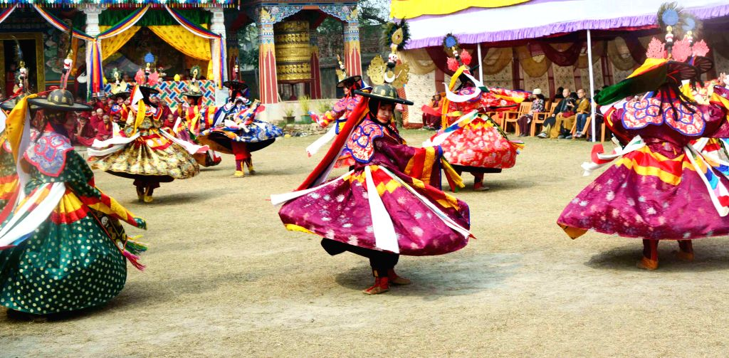 Artists dance for world peace at Bhutan temple in Bodhgaya, Bihar on Jan 13, 2015.