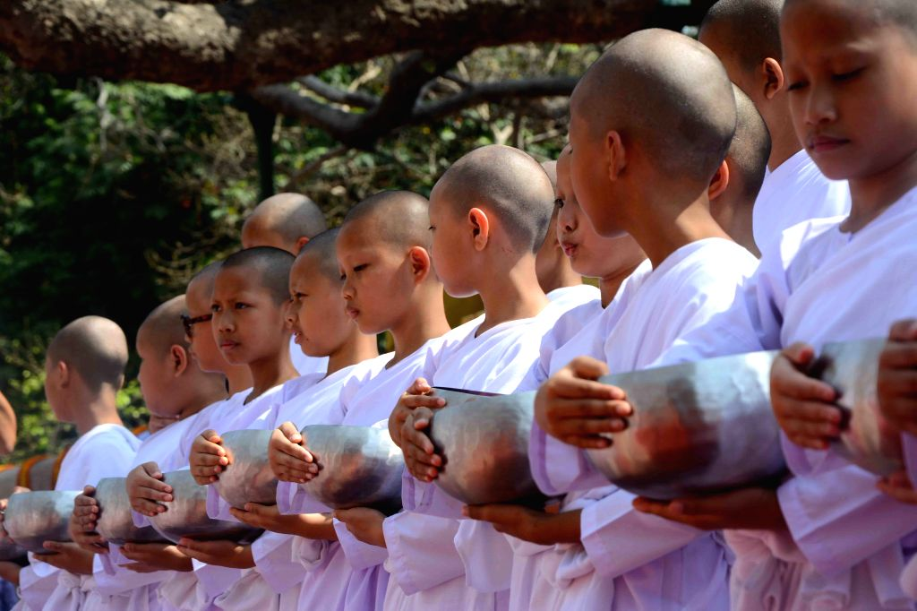Buddhist nuns from Thailand participate in a religious programme at the Mahabodhi Temple in Bodhgaya on April 1, 2015.
